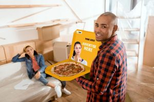 african american boyfriend bringing pizza for his girlfriend